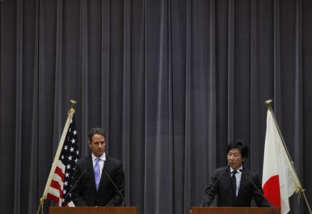Treasury Secretary Timothy Geithner and Japan's Finance Minister Jun Azumi attend a joint news conference at the Finance Ministry in Tokyo January 12, 2012.REUTERS/Toru Hanai