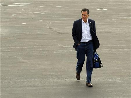 Mitt Romney walks across the tarmac to his campaign plane in Bedford, Massachusetts January 11, 2012.   REUTERS/Brian Snyder