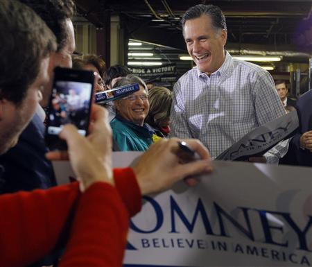 Mitt Romney greets supporters during a campaign stop at Cherokee Trikes and More in Greer, South Carolina January 12, 2012.   REUTERS/Brian Snyder