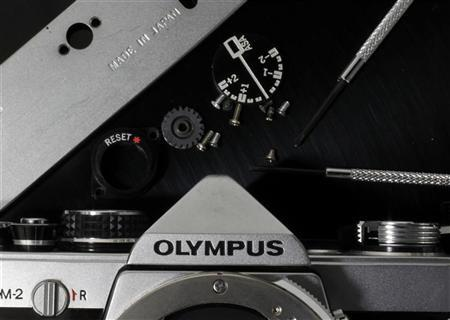 A disassembled Olympus camera and its parts are seen in this illustrative photograph taken in Tokyo, November 24, 2011. REUTERS/Kim Kyung-Hoon
