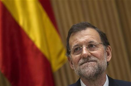 Spanish Prime Minister Mariano Rajoy gestures during a meeting with the People's Party parliament members in Madrid January 10, 2012. REUTERS/Juan Medina