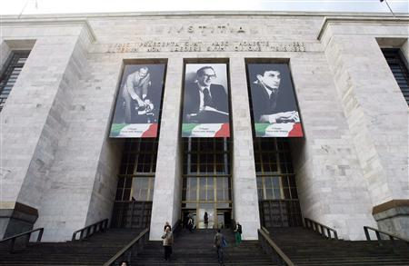 Banners depicting the pictures of Italian magistrates (L to R) Giorgio Ambrosoli, Emilio Alessandrini and Guido Galli killed more than 30 years ago, hang from the Justice Palace in Milan, May 9, 2011. REUTERS/Alessandro Garofalo