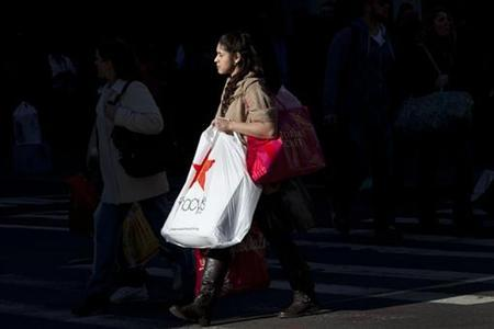 A Black Friday shopper crosses 34th Street outside Macy's in Herald Square in New York November 25, 2011. REUTERS/Andrew Burton