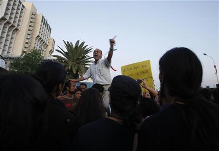 A Tunisian demonstrator shouts during a protest against the Islamist Ennahda movement in Tunis October 26, 2011. REUTERS/Zohra Bensemra