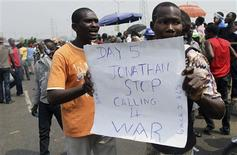 A man holds a sign at Gani Fawehinmi freedom square on the fifth day of a protest against a fuel subsidies removal, in Lagos January 13, 2012. REUTERS/Akintunde Akinleye