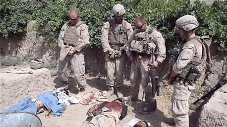 EDITOR'S NOTE: REUTERS CANNOT INDEPENDENTLY VERIFY CONTENT OF THE VIDEO FROM WHICH THIS STILL IMAGE WAS TAKEN. VISUAL COVERAGE OF SCENES OF INJURY OR DEATH A still image taken January 11, 2012 from an undated YouTube video shows what is believed to be U.S. Marines urinating on the bodies of dead Taliban soldiers in Afghanistan. REUTERS/YouTube RECEIVED BY REUTERS, AS A SERVICE TO CLIENTS