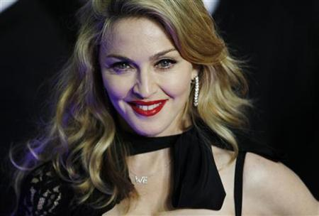 Director Madonna arrives for the premiere of her film W.E. in London January 11, 2012.    REUTERS/Luke MacGregor