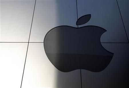 An Apple logo is seen with its light switched off at an Apple store in Tokyo October 6, 2011.  REUTERS/Yuriko Nakao