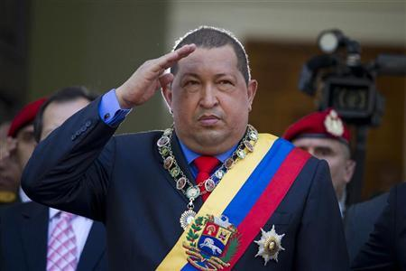 Venezuelan President Hugo Chavez salutes as he arrives at a the National Assembly to deliver his annual state of the nation in Caracas January 13, 2012. REUTERS/Carlos Garcia Rawlins