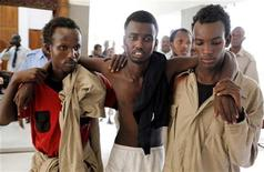 Suspected Somali pirates arrive at the law courts in the Kenyan coastal city of Mombasa, June 20, 2011.    REUTERS/Joseph Okanga
