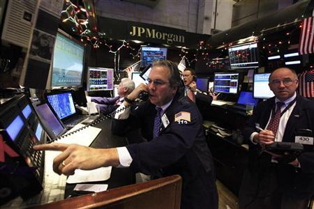 Specialists and traders work at the JP Morgan stall on the floor of the New York Stock Exchange, January 13, 2012. REUTERS/Brendan McDermid