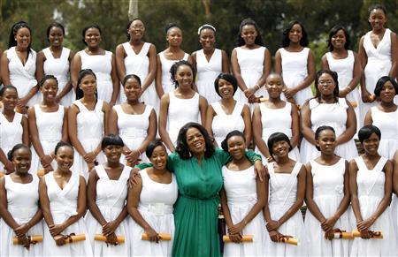 Entertainment host Oprah Winfrey (C) poses with high school students during her school's first graduation ceremony at the Oprah Winfrey Leadership Academy for Girls at Henley-on-Klip, outside Johannesburg January 14, 2012. REUTERS/Siphiwe Sibeko