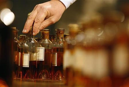 A technical expert takes a sample of Cognac in a cellar at the Hennessy factory in Cognac, southwestern France, January 22, 2009. REUTERS/Regis Duvignau