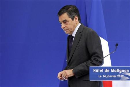 France's Prime Minister Francois Fillon delivers a speech as he attends a news conference at the Hotel Matignon in Paris January 14, 2012. France lost its triple-A credit rating with Standard & Poor's on Friday, putting it a notch below Germany in a blow to President Nicolas Sarkozy three months from a presidential election. REUTERS/Benoit Tessier