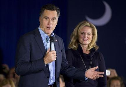 Republican presidential candidate and former Massachusetts Governor Mitt Romney (L) speaks as his wife Ann Romney (R) watches during a campaign stop at the American Legion Post in Sumpter, South Carolina, January 14, 2012. REUTERS/Chris Keane