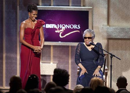 First Lady Michelle Obama (L) stands by BET honoree author Maya Angelou at the BET Honors in Washington January 14, 2012. REUTERS/Joshua Roberts