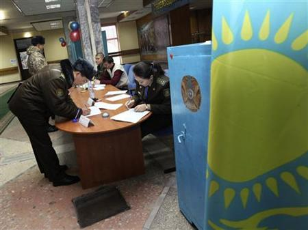A serviceman registers before voting at the Frontier Academy under the National Security Committee during parliamentary elections in Almaty January 15, 2012. REUTERS/Pavel Mikheev