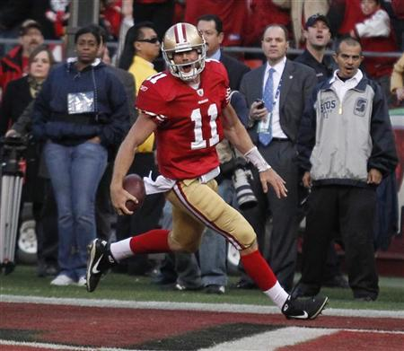 San Francisco 49ers quarterback Alex Smith scores a touchdown in the fourth quarter of play against the New Orleans Saints during their NFL NFC Divisional playoff football game in San Francisco, California, January 14, 2012. REUTERS/Beck Diefenbach