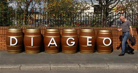 A man walks past barrels outside the Diageo Shieldhall facility near Glasgow, Scotland August 26, 2010.   REUTERS/David Moir