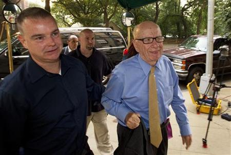 News Corporation Chairman and Chief Executive Rupert Murdoch (R) arrives at his home in New York July 20, 2011.  REUTERS/Lucas Jackson