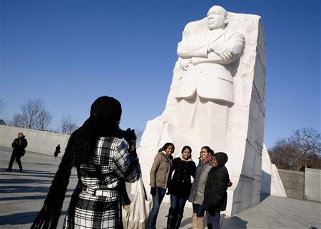 Women have their photo taken at the Martin Luther King, Jr. memorial on his 83rd birthday in Washington January 15, 2012.    REUTERS/Joshua Roberts