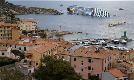 A view shows the Costa Concordia cruise ship that ran aground off the west coast of Italy, at Giglio island January 15, 2012. REUTERS/ Max Rossi