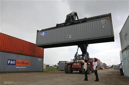 A mobile crane prepares to stack a container at Thar Dry Port in Sanand in August 1, 2011. REUTERS/Amit Dave/Files