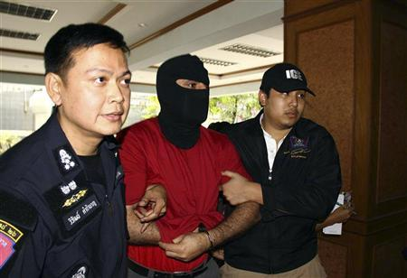 Thai police officers escort a Lebanese man (C) suspected of planning an attack, upon arrival at the Border Patrol Police Bureau in Bangkok January 16, 2012.    REUTERS/Stringer