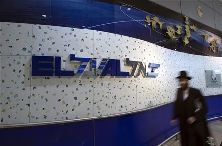 An ultra-Orthodox Jewish man walks past an El Al Israel Airlines logo at Ben Gurion International airport near Tel Aviv,in this file picture taken August 22, 2011.  REUTERS/Ronen Zvulun/Files