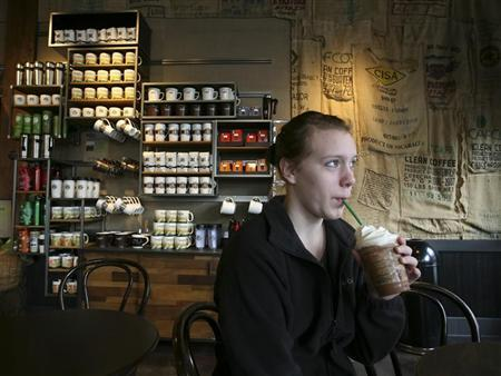 Mckenzie Harguth drinks her Frappuccino at a Starbucks store at 1st and Pike in Seattle, Washington, March 25, 2010.  REUTERS/Marcus Donner
