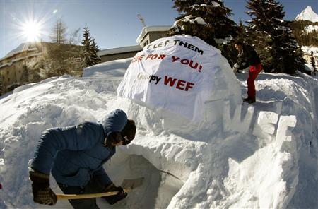 A member of the Occupy WEF movement uses a shovel to extend the entrance of the first igloo at their camp site in the Swiss mountain resort of Davos January 16, 2012. The Occupy WEF members will stay in a camp of several igloos to protest during the World Economic Forum (WEF) which takes place from January 25 to 29.     REUTERS/Arnd Wiegmann