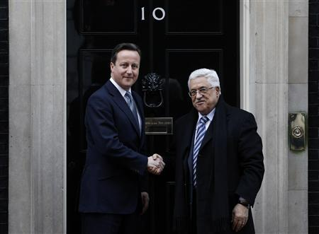 Britain's Prime Minister David Cameron (L) greets Mahmoud Abbas, the President of Palestinian Authority outside 10 Downing Street in central London, January 16, 2012.  REUTERS/Andrew Winning