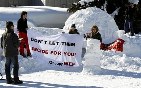Katharina Prelicz-Huber (R) president of the VPOD public workers union addresses the media in front of the first igloo of the Occupy WEF movement at their camp site in the Swiss mountain resort of Davos January 16, 2012.  REUTERS/Arnd Wiegmann