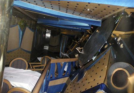 Furniture is seen inside the Costa Concordia cruise ship that ran aground off the west coast of Italy, at Giglio island January 16, 2012.  REUTERS/Guardia Costiera/Handout