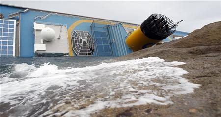 The Costa Concordia cruise ship is seen after it ran aground off the west coast of Italy, at Giglio island January 16, 2012.   REUTERS/ Max Rossi