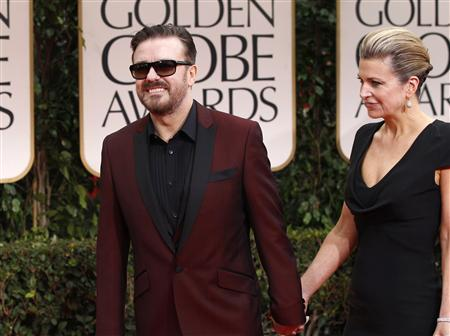 Host Ricky Gervais and partner Jane Fallon arrive at the 69th annual Golden Globe Awards in Beverly Hills, California January 15, 2012.  REUTERS/Mario Anzuoni