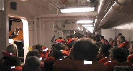 Passengers put on life vests along the corridors of the Costa Concordia cruise ship near Giglio, Italy, January 13, 2012 in this still image taken from an amateur video shot by a German passenger and obtained January 14, 2012.  REUTERS/Amateur Video via Reuters TV