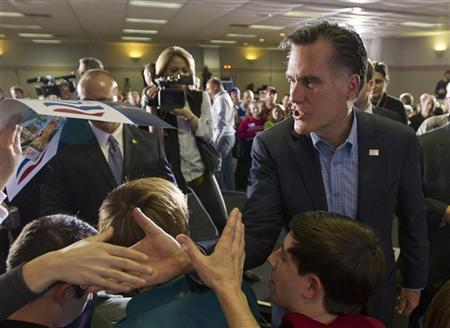Republican presidential candidate and former Massachusetts Governor Mitt Romney shakes hands with supporters during a campaign stop at the American Legion Post in Sumpter, South Carolina, January 14, 2012. REUTERS/Chris Keane
