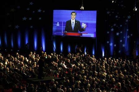 Republican presidential candidate former Massachusetts Governor Mitt Romney is seen on a giant TV screen in a Republican presidential candidates debate in Myrtle Beach, South Carolina,  January 16, 2012. REUTERS/Jason Reed