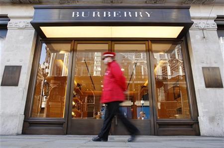 A pedestrian walks past a Burberry shop in London November 19, 2008. REUTERS/Suzanne Plunkett