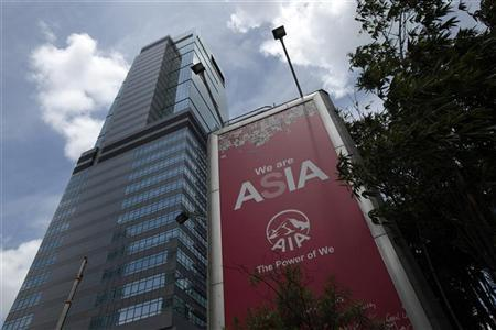 An advertisement for AIA (American International Assurance) is displayed on the outside of AIA Tower in Hong Kong July 13, 2010. REUTERS/Tyrone Siu