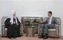 Президент Сирии Башар Асад и Патриарх Московский и всея Руси Кирилл на встрече в Дамаске 13 ноября 2011. Очередной российский проект резолюции, связанной с насилием в Сирии, вызвал замешательство у Совета безопасности ООН и не внес ясности в вопрос, согласится ли Москва с требуемыми Западом жесткими мерами в отношении режима Башара Асада, сказали западные дипломаты. REUTERS/ Sana/Handout
