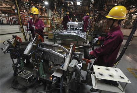 Employees weld automobiles at Anhui Jianghuai Automobile Co. Ltd (JAC Motors) in Hefei, Anhui province October 18, 2011. REUTERS/Stringer