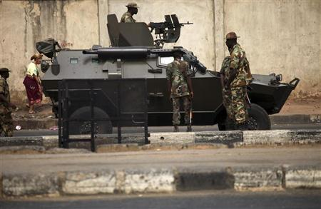 Soldiers stand guard with an armoured vehicle on a road at the resumption of a nationwide strike against the removal of fuel subsidies in Lagos January 16, 2012. REUTERS/Akintunde Akinleye