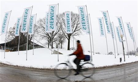 A shareholder arrives for Siemens annual shareholders meeting in Munich January 25, 2011. REUTERS/Michaela Rehle