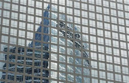 The Goldman Sachs headquarters building is reflected in the windows of a neighboring building in New York, July 19, 2010.  REUTERS/Lucas Jackson