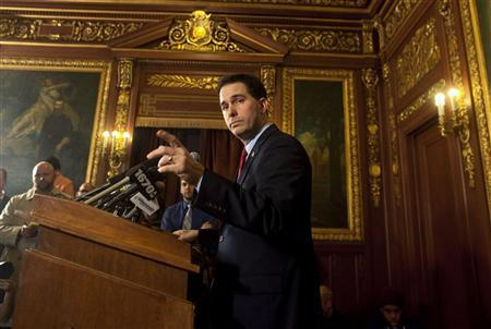 Wisconsin Republican Governor Scott Walker speaks to the media about his proposed budget cuts reducing public employee union bargaining powers and benefits in Madison, Wisconsin February 21, 2011.  REUTERS/Darren Hauck