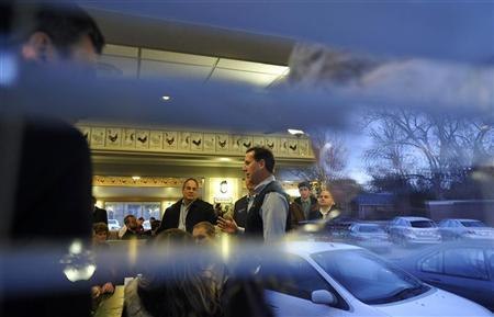 Republican presidential candidate and former Pennsylvania Senator Rick Santorum (center R) speaks to the media during a campaign stop at the Lizard's Thicket restaurant in Columbia, South Carolina January 16, 2012. Santorum addressed recent campaign advertisements from Super PACs backing Mitt Romney saying they were factually incorrect and were ''flat-out lies.'' REUTERS/Rainier Ehrhardt