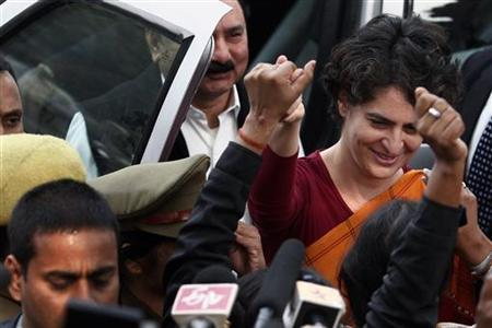 Priyanka Gandhi, daughter of the chief of the ruling Congress party Sonia Gandhi, holds hands with Congress party supporters during a stopover in Rae Bareli district as part of her pre-election campaign in Uttar Pradesh January 17, 2012. REUTERS/Adnan Abidi