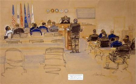 In this sketch approved by the military by court artist Janet Hamlin, and obtained by Reuters on November 9, 2011, Abd Al Rahim Hussayn Muhammad al-Nashiri's Defense Attorney Richard Kammin (C) addresses the military judge. Abd Al Rahim Hussayn Muhammad Al Nashiri is seen here during his military commissions arraignment.   REUTERS/Janet Hamlin